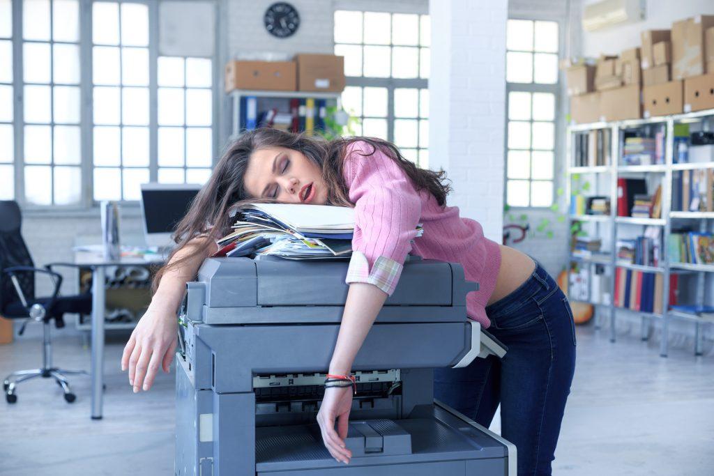 Tired employee who needs sleep.