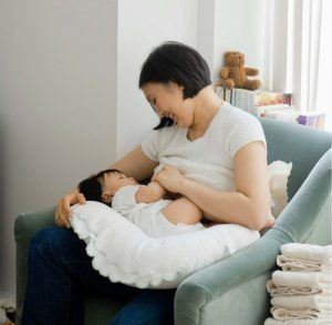 mom breastfeeding baby in a comfy chair